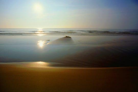 Sunrise Lake Michigan, photograph by John Rohrer.