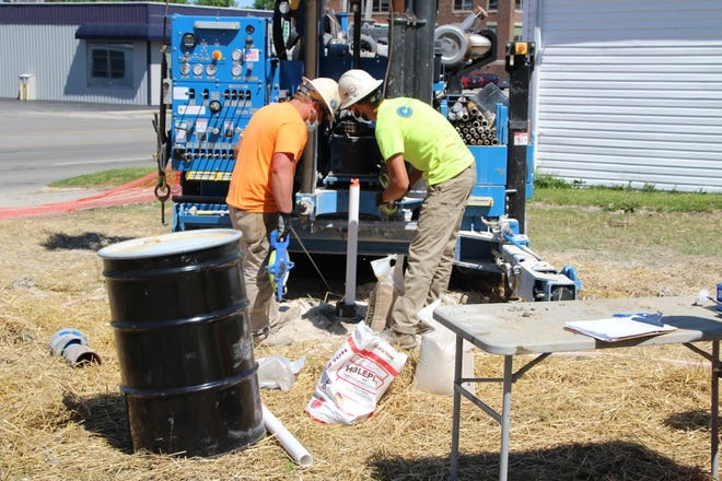 A crew from Envirocore, Inc. of Plaint City installs monitoring wells on Monday, June 8, 2020, at the former Clark gas station site at 770 N. Main St. in Marion. The site is being cleaned up after setting vacant for many years. Crews from Buckeye Elm Contracting of Worthington have removed fuel tanks from the site.
