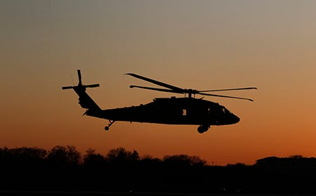 Wisconsin National Guard Soldiers fly a UH-60 Black Hawk as part of a night flight exercise in Madison in April. Around 35 soldiers in a West Bend-based helicopter unit are deploying to the Middle East this summer.