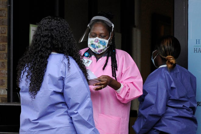 Health care workers shown at a coronavirus testing site in rural Hayneville, Ala. Health equity is when quality of care does not vary based on location, race, socioeconomic status or other factors, and COVID-19 has exacerbated the likelihood of worse health outcomes in rural areas.