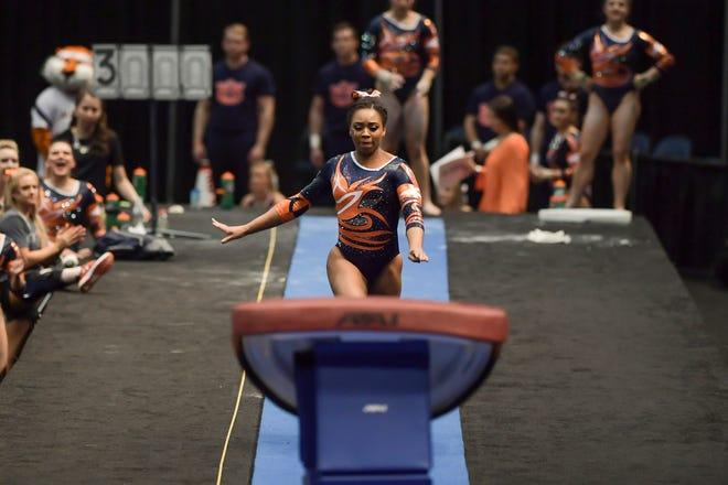 Auburn gymnast A'Miracal Phillips competes on vault against Alabama during the 'Elevate the Stage' meet on Sunday, Jan. 29, 2017 in Birmingham, Ala.