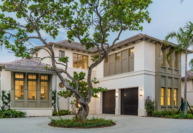 Priced at $13,475,000, the custom 4395 Gordon Drive estate in Port Royal is open for viewing and features an open great room plan that showcases views of Cutlass Cove and the beautiful greens of mangroves on Keewaydin Island.