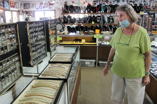 Peggy Davis, owner of The Blue Stone, shows the jewelry that was stolen and then returned June 10, 2020.