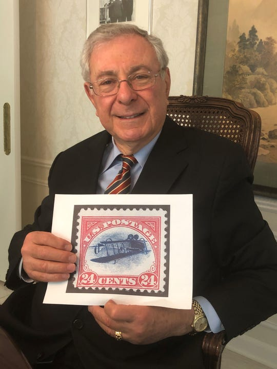 Ronald Bassey of Bloomfield Township holds a photocopy of the real inverted Jenny stamp he has secretly owned for 43 years and kept in a bank vault. The stamp will be sold at auction on July 1, 2020 and is expected to bring at least $200,000.