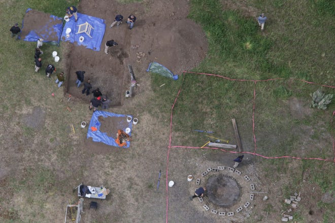 In this aerial photo, investigators search for human remains at Chad Daybell's residence in the 200 block of 1900 East, Tuesday, June 9, 2020, in Salem, Idaho. Authorities say they uncovered human remains at Daybell's home as they investigated the disappearance of his new wife's two children. Police in the small town of Rexburg say Daybell was taken into custody Tuesday. He had recently married the children's mother, Lori Vallow Daybell, who has been charged with child abandonment. (John Roark/The Idaho Post-Register via AP)