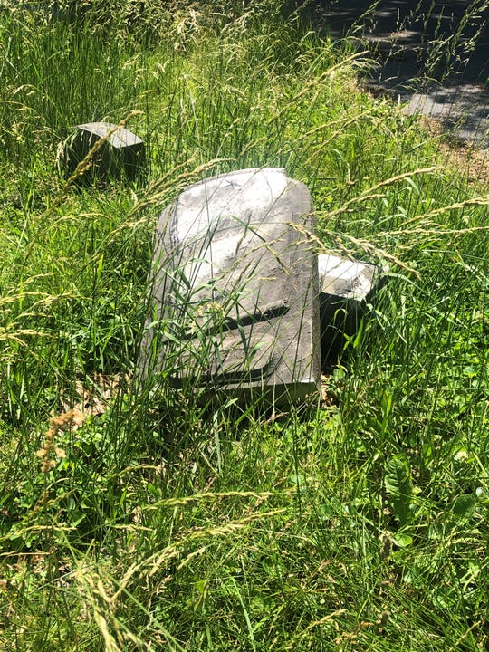Old grave markers have broken off in a few places at Mount Lebanon Cemetery in Lebanon, Pennsylvania, and grass grows around many of the markers on the grounds.