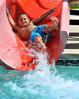 Azure Boxley, 7, of York City, glides down the slide at Graham Aquatic Center-YMCA as the heat index reaches the mid 90's in York City, Wednesday, June 10, 2020. Dawn J. Sagert photo