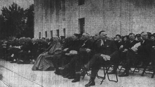A crowd of dignitaries attending the dedication of the new Oregon State Capitol on Oct. 1, 1938 sit near where two massive marble sculptures will eventually be installed.