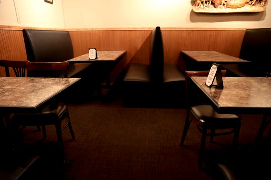 Signs are used to space out guests to accommodate for social distancing at Geppetto's Italian Restaurant in Salem on Monday, June 8, 2020. Under Phase 1 reopening guidelines, tables in  dining areas must be spaced at least 6 feet apart.