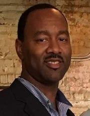 Airline assistant coach Marvin Davis