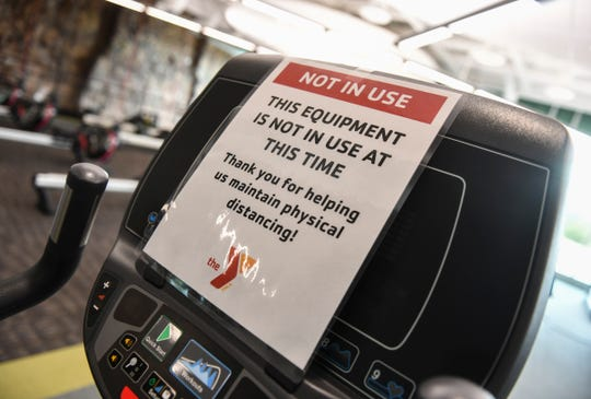 Signs mark machines closed to keep distancing guidelines intact Wednesday, June 10, 2020, at the St. Cloud Area Family YMCA.