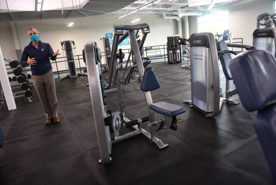 Executive Director Greg Gack talks about distancing measures in place with equipment Wednesday, June 10, 2020, at the St. Cloud Area Family YMCA.