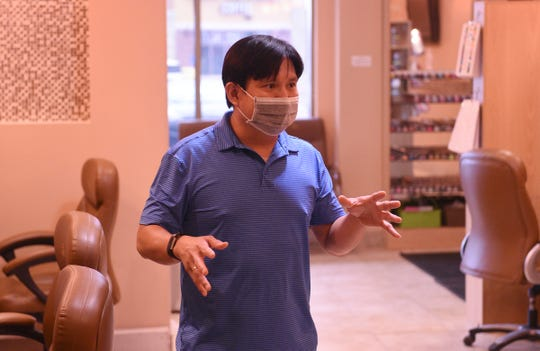 Evol Nails owner and nail technician Luong Tran speaks about his business Wednesday, June 10, 2020, in Sartell.