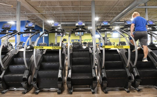 Tape is placed on machines to ensure social distancing at STa-FIT Wednesday, June 10, 2020, in Sartell.