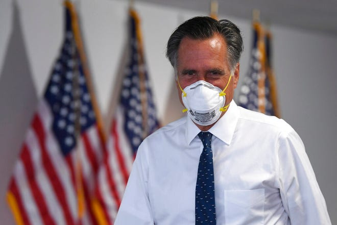Sen. Mitt Romney, R-Utah, leaves a Republican luncheon on Capitol Hill in Washington, Thursday, June 4, 2020. (AP Photo/Susan Walsh)