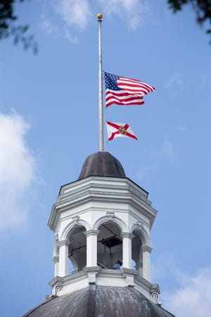 A Capitol employee lowers the U.S. and Florida flags to half-staff Wednesday, June 10, 2020. Gov. Ron DeSantis ordered the flags lowered to honor the late Senate President Gwen Margolis. She died Tuesday.