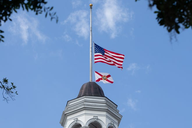 The U.S. and Florida flags fly at half-staff above the Florida Historic Capitol Wednesday, June 10, 2020 after Gov. Ron DeSantis issued a memorandum that flags at the Miami-Made County Courthouse, City Hall of Miami and the Capitol be lowered to honor former Senate President Gwen Margolis.