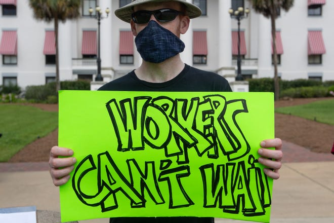 A man who wished to remain anonymous protests the state's broken unemployment system in front of the Florida Historic Capitol Wednesday, June 10, 2020.