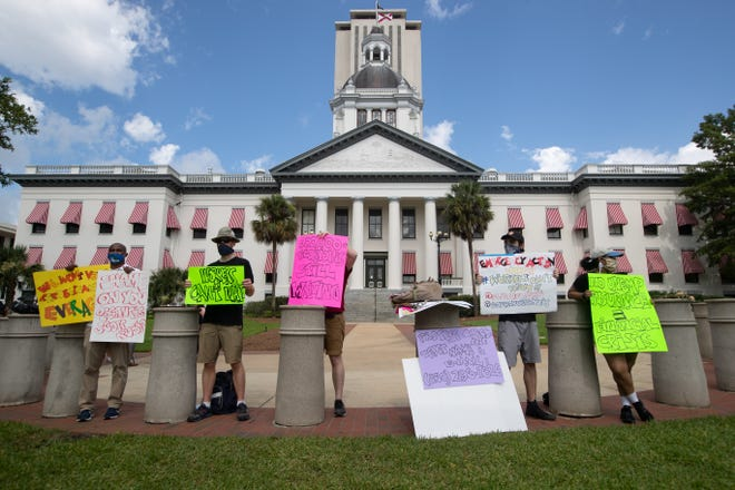A group of six protested the state's broken unemployment system in front of the Florida Historic Capitol on June 10, 2020.
