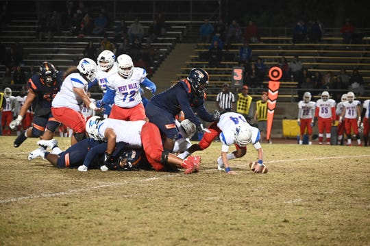 College of the Sequoias' defensive lineman Corleone Peters sacks a West Hills quarterback during the 2019 season.
