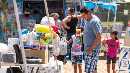Vendors reunite with shoppers Wednesday, June 10, 2020 at the Tulare County Fairgrounds Swap Meet after a closing for COVID-19 concerns. It will be open each Wednesday starting June 10 at 10 a.m.