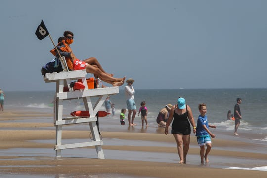 Lifeguards watch over crowded Bethany Beach on a warm, windy Wednesday, June 10th.  They were trained to work in rescue teams and, if possible, to wear masks and gloves based on corona viruses.