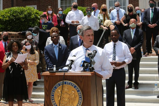 Delaware Governor John Carney (podium) was joined by other elected officials Wednesday afternoon in Dover in calling for new legislation to address police brutality and racial injustice in the state.