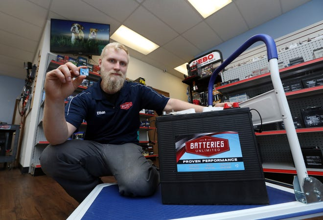 Ethan Curry owns Batteries Unlimited on Linden Avenue in Zanesville. The store carries batteries ranging in size from tiny watch batteries to batteries for ride-on floor cleaners, and 120 pound bulldozer batteries.
