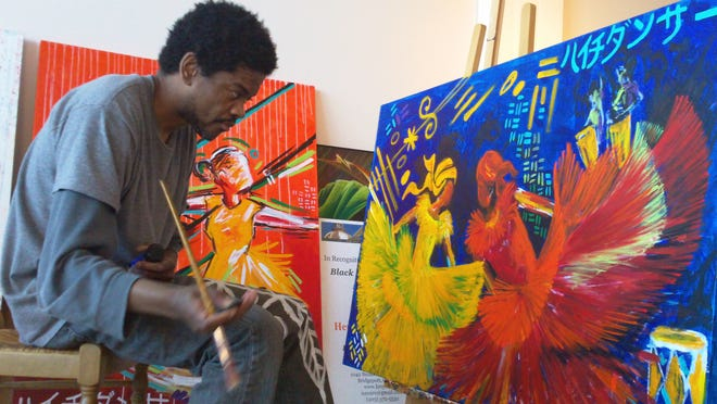 Hertz Nazaire, who has had sickle cell disease since he was six months old, is shown in his art studio