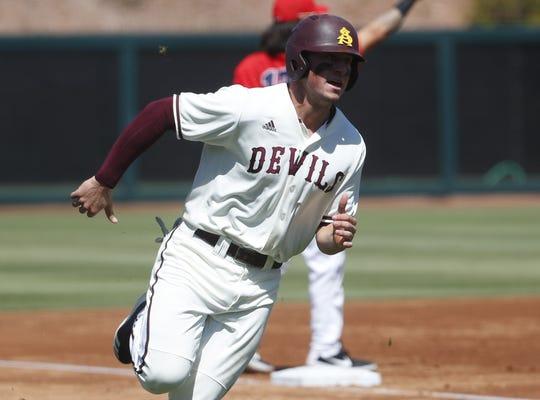 ASU's Spencer Torkelson (20) scores against Arizona during a game at Phoenix Municipal Stadium in Phoenix, Ariz. on March 30, 2019.