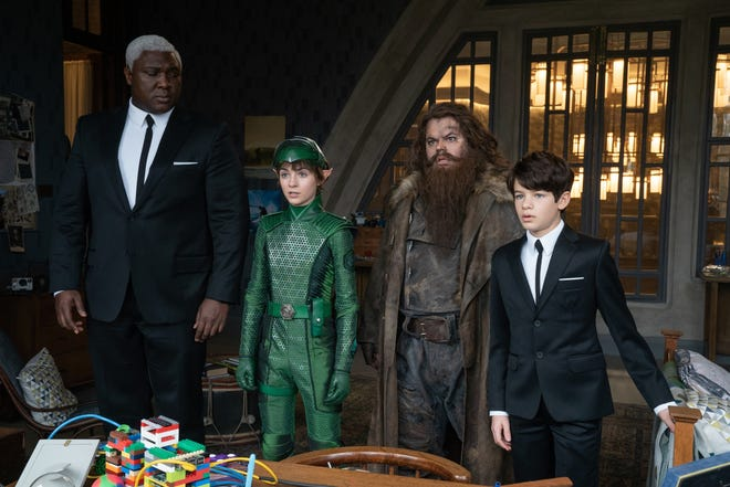 """Artemis (Ferdia Shaw, right) gets help from loyal bodyboard Domovoi Butler (Nonso Anozie, from left), fairy cop Holly Short (Lara McDonnell) and thieving supersized dwarf Mulch Diggums (Josh Gad) in the fantasy adventure """"Artemis Fowl."""""""