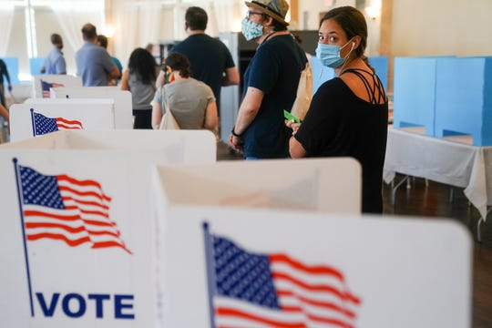 People wait in line to vote in Georgia's primary election June 9 in Atlanta.