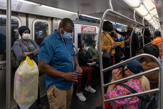 People ride the subway on the first day of phase one of the reopening after the coronavirus lockdown on June 8, 2020 in New York City. New York City enters phase one one hundred days after the first confirmed case of Covid-19.