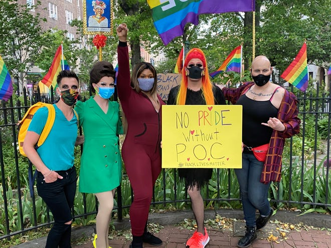 Miz Cracker (holding the sign) has been advocating for the Black Lives Matter movement and encouraging fans to join her in recent days.