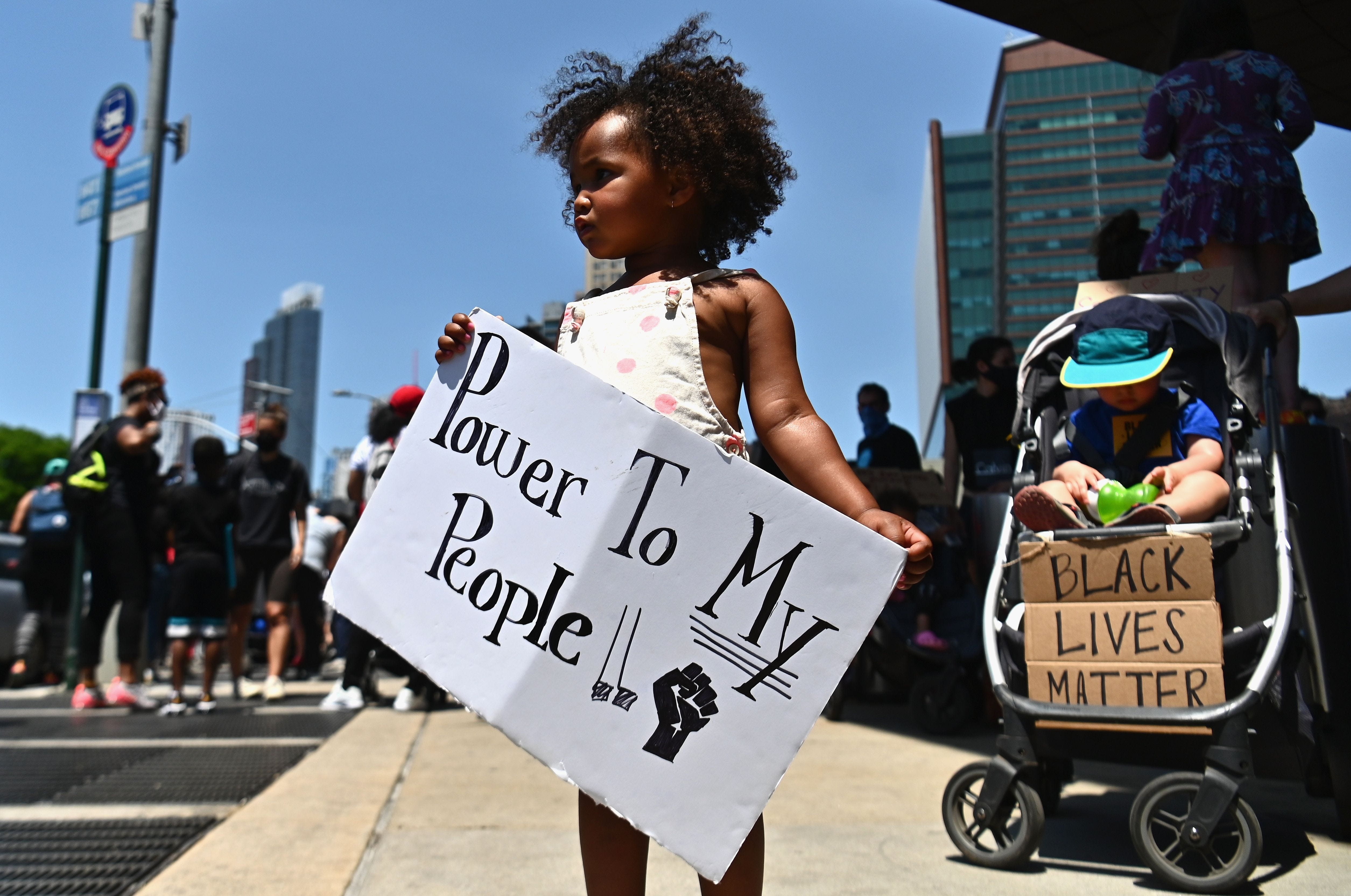 Families participate in a children's march in solidarity with the Black Lives Matter movement and national protests against police brutality on June 9, 2020, in the Brooklyn borough of New York City.