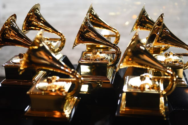 (FILES) In this file photo taken on January 28, 2018 Grammy trophies sit in the press room during the 60th Annual Grammy Awards in New York.