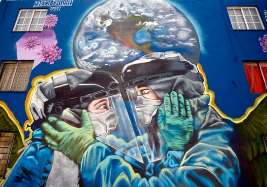 A coronavirus-related mural in Mexico City, photographed on June 9, 2020.