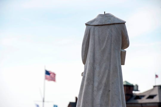 A decapitated statue of Christopher Columbus is viewed at Christopher Columbus Park in Boston on June 10, 2020. The statue's head, damaged overnight, was recovered by the Boston Police Department, as a movement to remove statues commemorating slavers and colonizers continues to sweep across the U.S.
