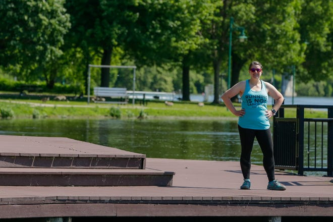 Carrie Kreps Wegenast poses for a portrait on Thursday, June 11, 2020, at Lutz Park in Appleton, Wis. Wegenast will be running through Lutz Park during the 20 mile mark of her marathon. The route for her marathon was made up of her favorite places to train.