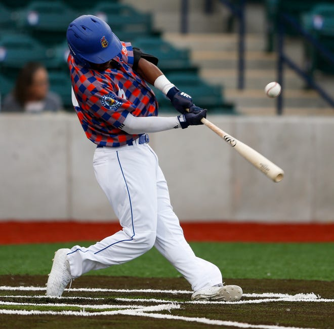 Green Bay's Jarrett Ford swings at a pitch during the Northwoods League baseball game between the Fond du Lac Dock Spiders and the Green Bay Booyah at Capital Credit Union Park on June 19, 2019, in Green Bay.