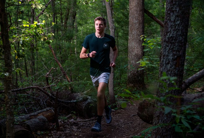"Connor Mailander, 17, plans to run 100 miles on the Mountains-to-Sea trail starting in Mill River on June 19-20. The run is to raise money for OpenDoors' ""To and Through college access program."""