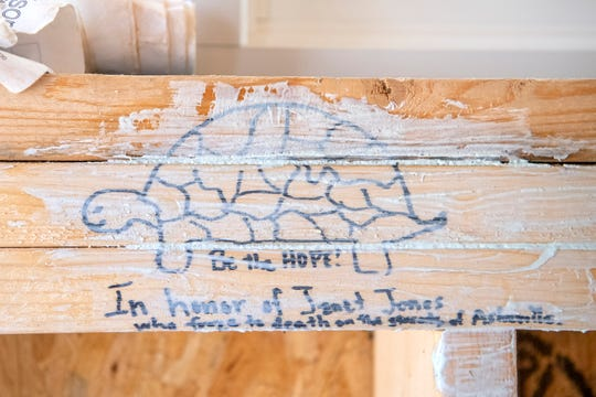 A tribute to Janet Jones, the catalyst for the BeLoved Asheville Village, is drawn on one of the beams inside the model home of the future community. Jones, who loved turtles, froze to death while sleeping by the French Broad River in 2016.