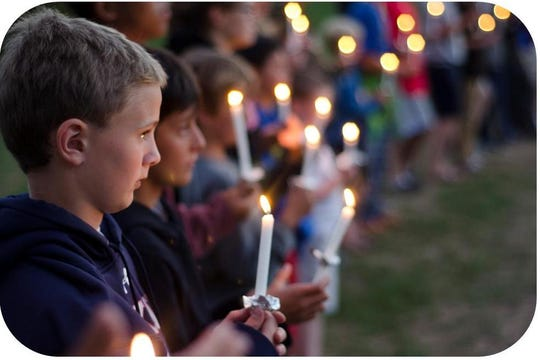 Camp Abnaki campers participate in a candelight camp ceremony. This and other camp events won't happen this year as the camp decided to close for the summer 2020 season because of the COVID-19 pandemic.