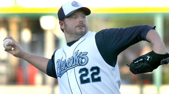 Roger Clemens throws a pitch in the first inning in front of 9,022 fans at Whataburger Field. Clemens struck out 11 in six innings in the Hooks 5-1 win.
