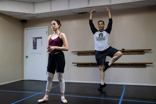 Nathan Reagan, owner of YAPP 361 Dance Studio, instructs his student Isabella Ranson on Thursday, June 11, 2020.