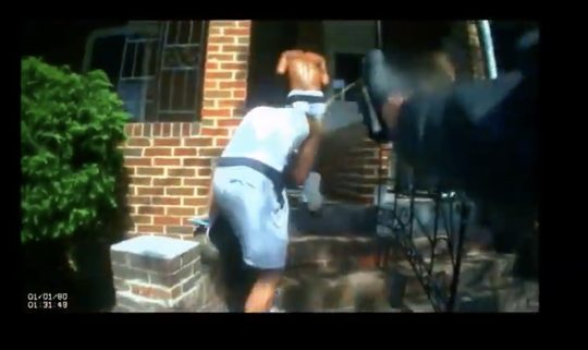 A screen shot from body camera video released Thursday seems to show Woodlynne Police Officer Ryan Dubiel pepper spraying a young man.