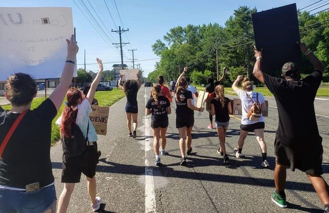 Protestors in Franklin Township march NJ Route 47 in the Franklinville section supporting the Black Lives Matter movement June 8, 2020. A now-fired FedEx employee went viral for reenacting the death of George Floyd on is property on the protest route as the march passed.