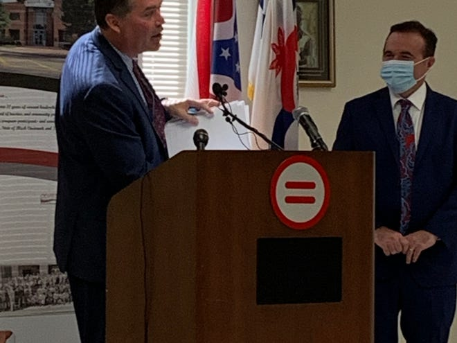 Assistant City Manager Chris Bigham, who oversees the city's budget, details some of what's in the 2021 budget a press conference on June 11, 2020. Right: Mayor John Cranley.