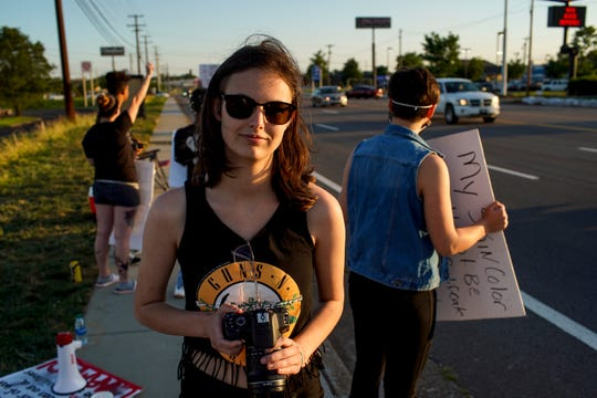 Ray Huerta, 21, documents the local protests at the sidewalk across from O'Charley's on Wilma Rudolph in Clarksville, Tenn., on Wednesday, June 10, 2020.