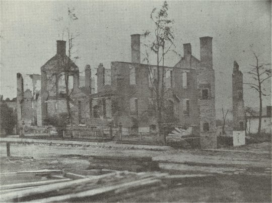"""Ruins of Central Hotel on the west side of South Second Street after the Great Fire of 1878 in Clarksville, Tenn., from """"Homes & Happenings"""" by Eleanor S. Williams & Ursula S. Beach."""